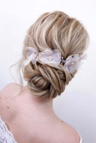 A Messy Twisted Updo With Accessories #weddingupdo #weddinghair #longhairstyles #hairaccessories