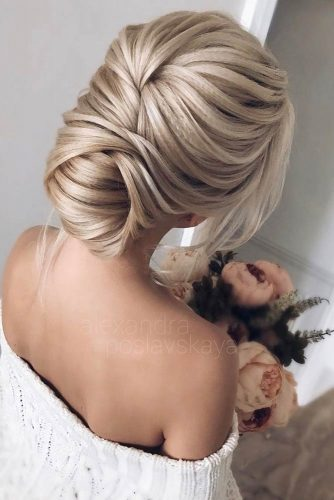 An Elegant Textured Updo #weddinghair #weddingupdos #classichairstyles #longhairstyles