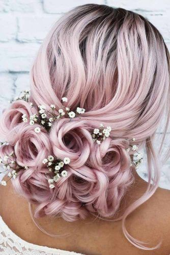 Rose Updo With Flowers #weddingupdo #weddinghair #hairstyles #updohairstyles