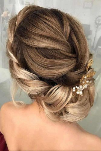A Twisted Halo Braid #weddingupdo #weddinghai #halobraid #twistedupdo #braidedcrown