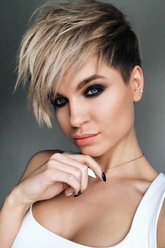 Edgy Layered Pixie Cut With Long Bang #asymmetricalpixie #shorthair #pixiehaircut #haircuts #layeredhair