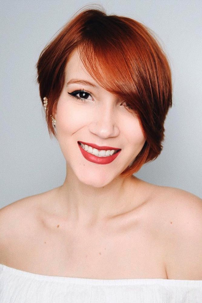 Long Asymmetrical Pixie For Straight Hair With Side Bangs #asymmetricalpixie #shorthair #pixiehaircut #haircuts #auburnhair