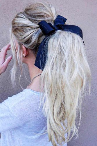Messy Ponytail With A Cute Bow #ponytail #ponytailhairstyles #hairstyles #longhair #blondehair