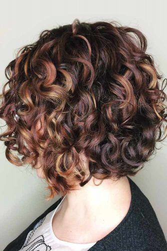 Medium Curly Bob With Red Highlights #curlybob #haircuts #bobhaircuts