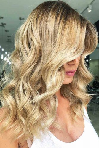 Rich And Elegant Golden Blonde #blondehair #wavyhair