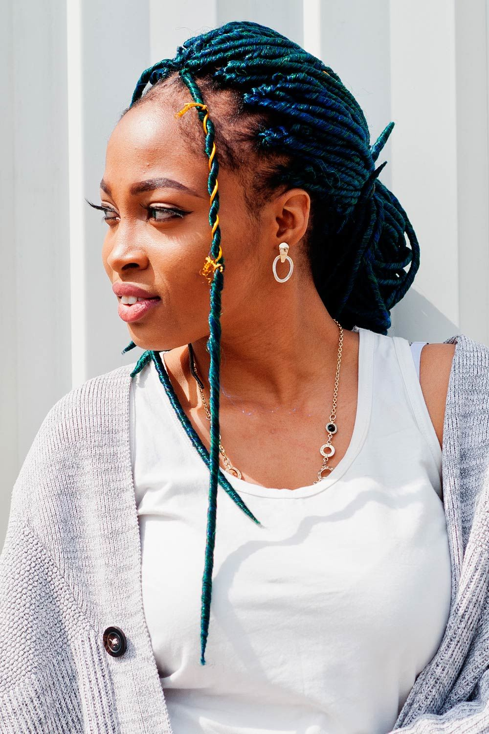 Blue Dreads Styled Into Low Bun
