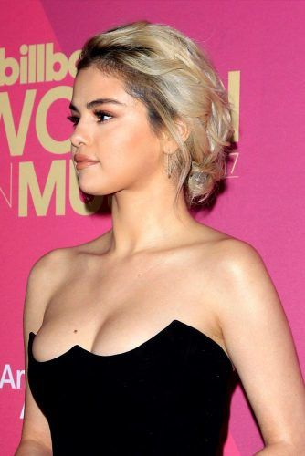 Low Messy Updo #selenagomez #selenagomezhairstyles #hairstyles #haircuts
