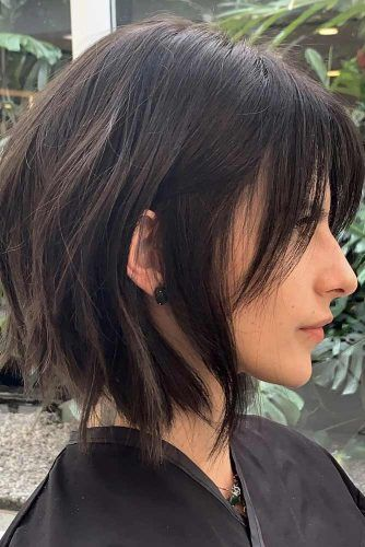 Black Choppy Bob With Center Parted Bangs #choppybob #bobhairstyles #bobhaircuts #hairstyles #haircuts