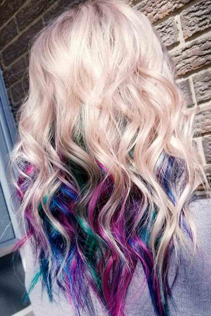 Long wavy blonde hair with hidden rainbow