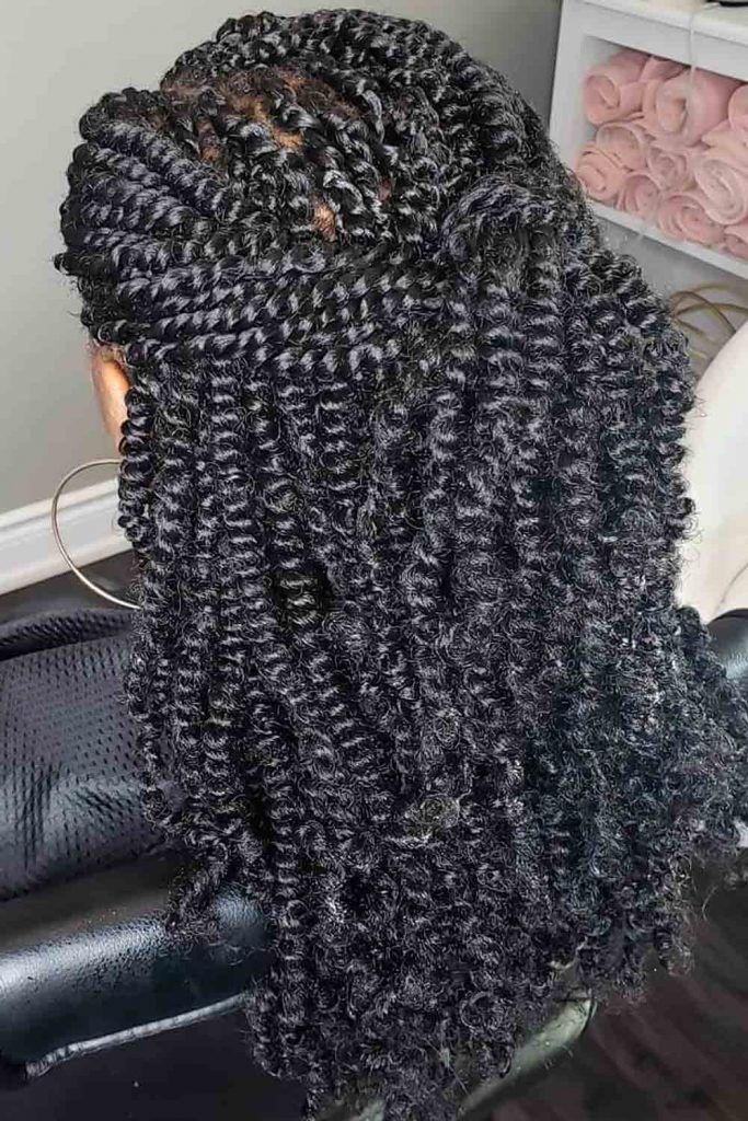 Long dark spring twisted hair updo