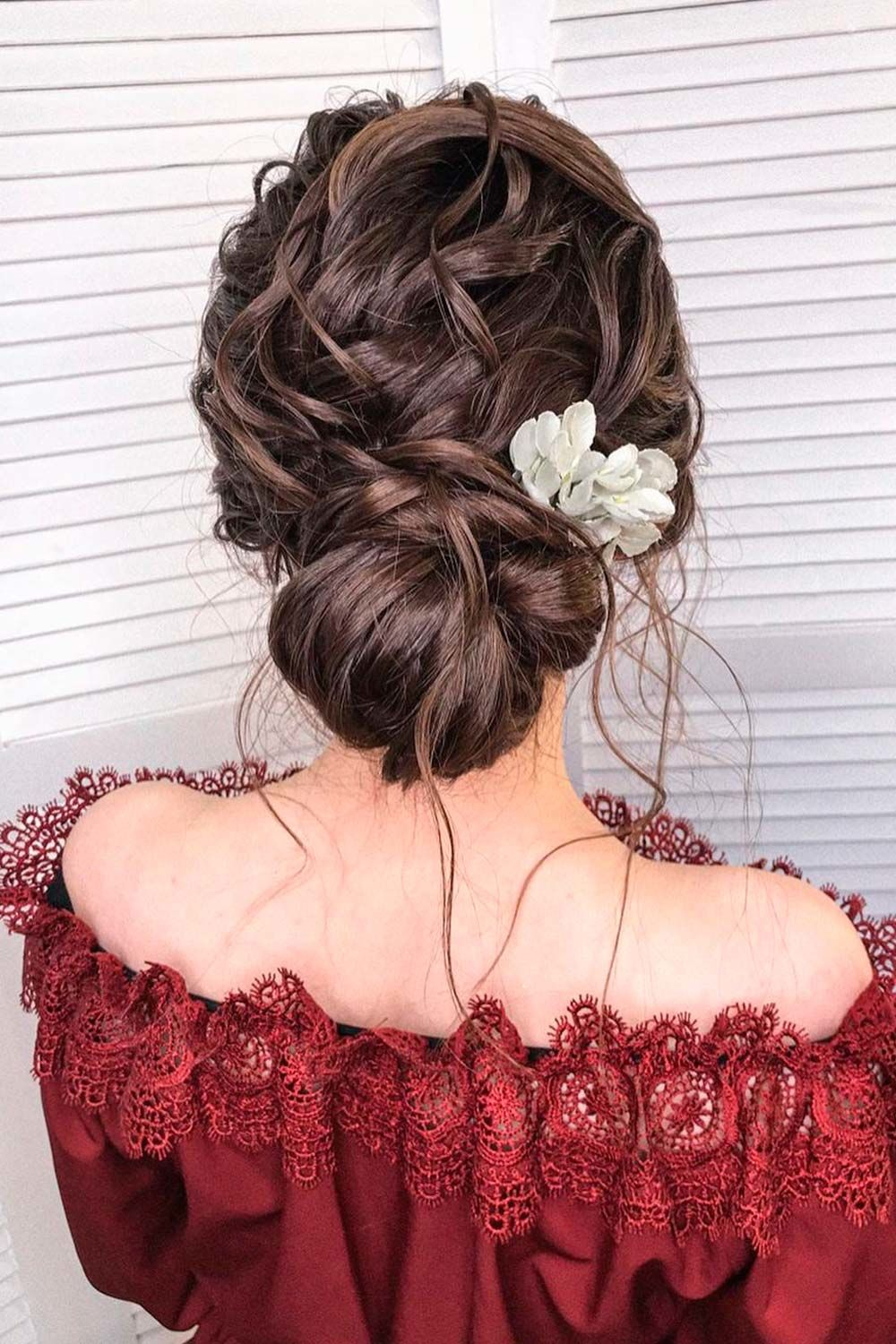 Low Messy Bun With Flowers