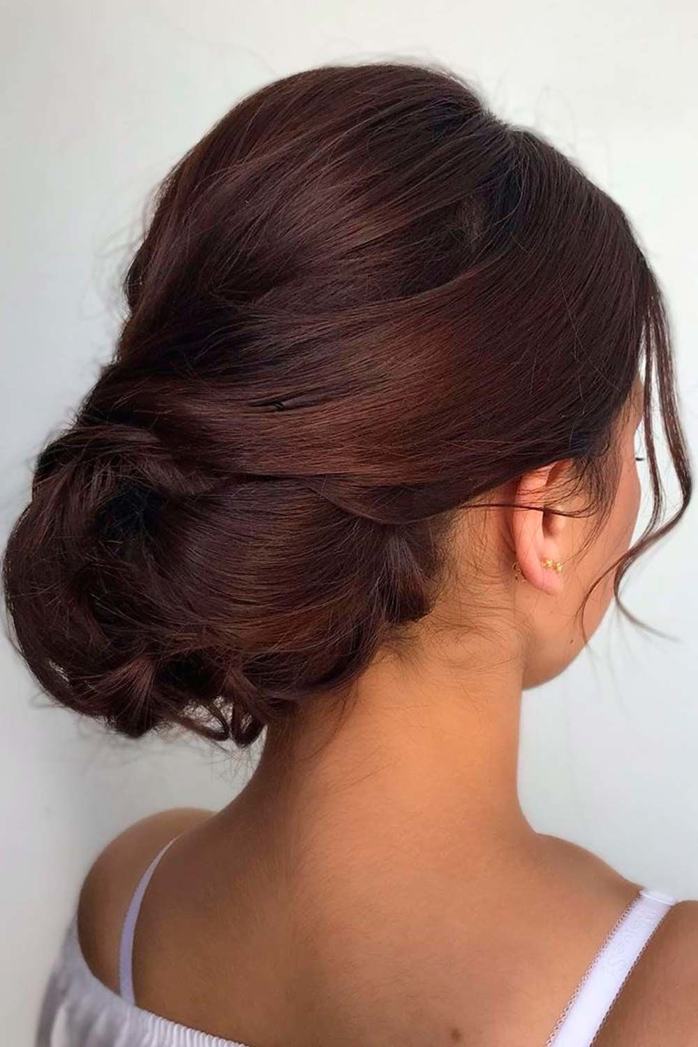 Swept Back Updos With Face Framing Pieces