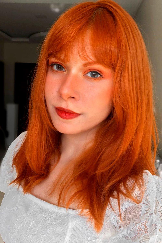 Red Medium Hair With Curtain Bangs