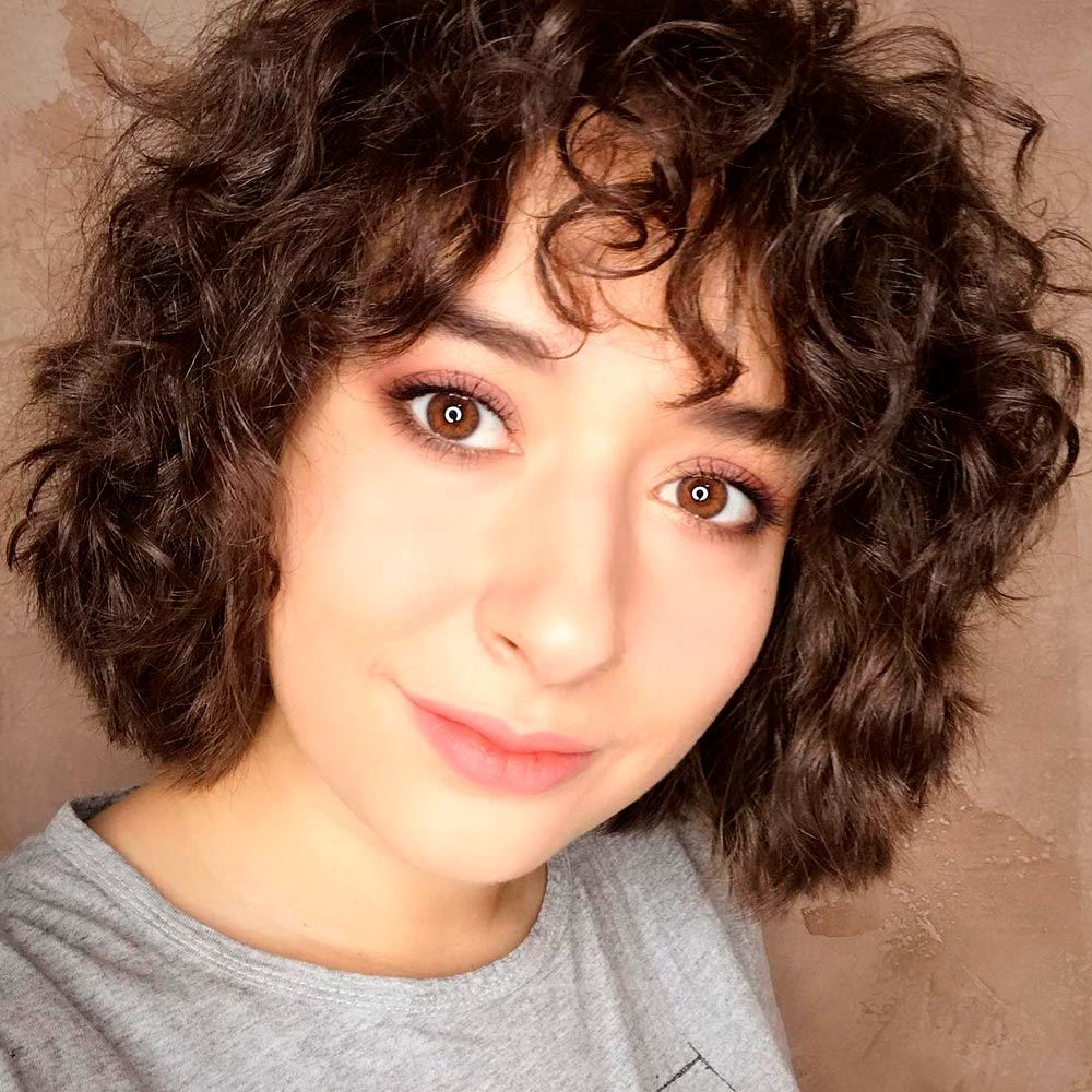 Curly Hair Bangs Trend, short curly hair bangs, how to style curly bangs, bangs on curly hair, curly bangs hairstyle