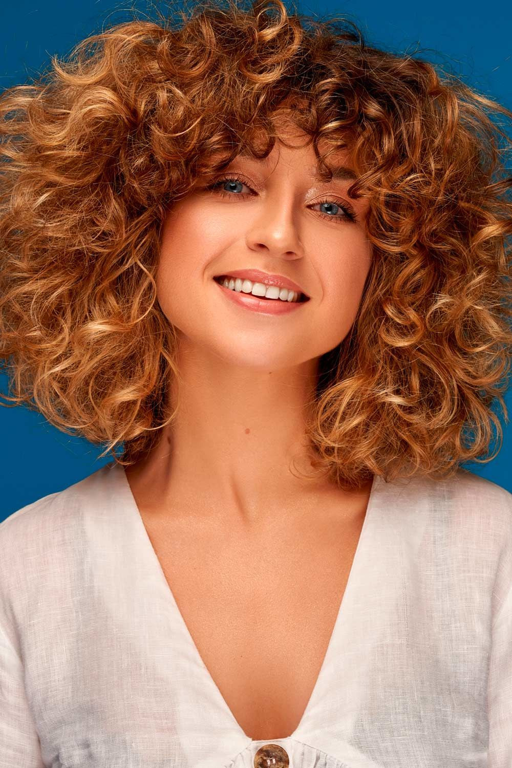 Pro Tricks to Rock Curly Bangs, shoulder length curly hair with bangs, curly clip in bangs, curly bob bangs