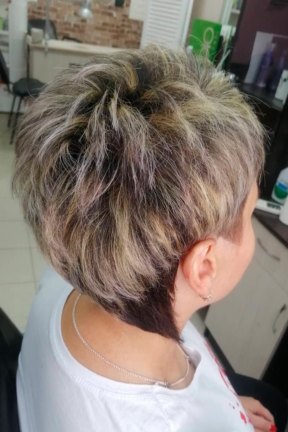 Edgy Pixie With Highlights, short hairstyles for older black women, hairstyles for short hair older women, short curly hairstyles for older women