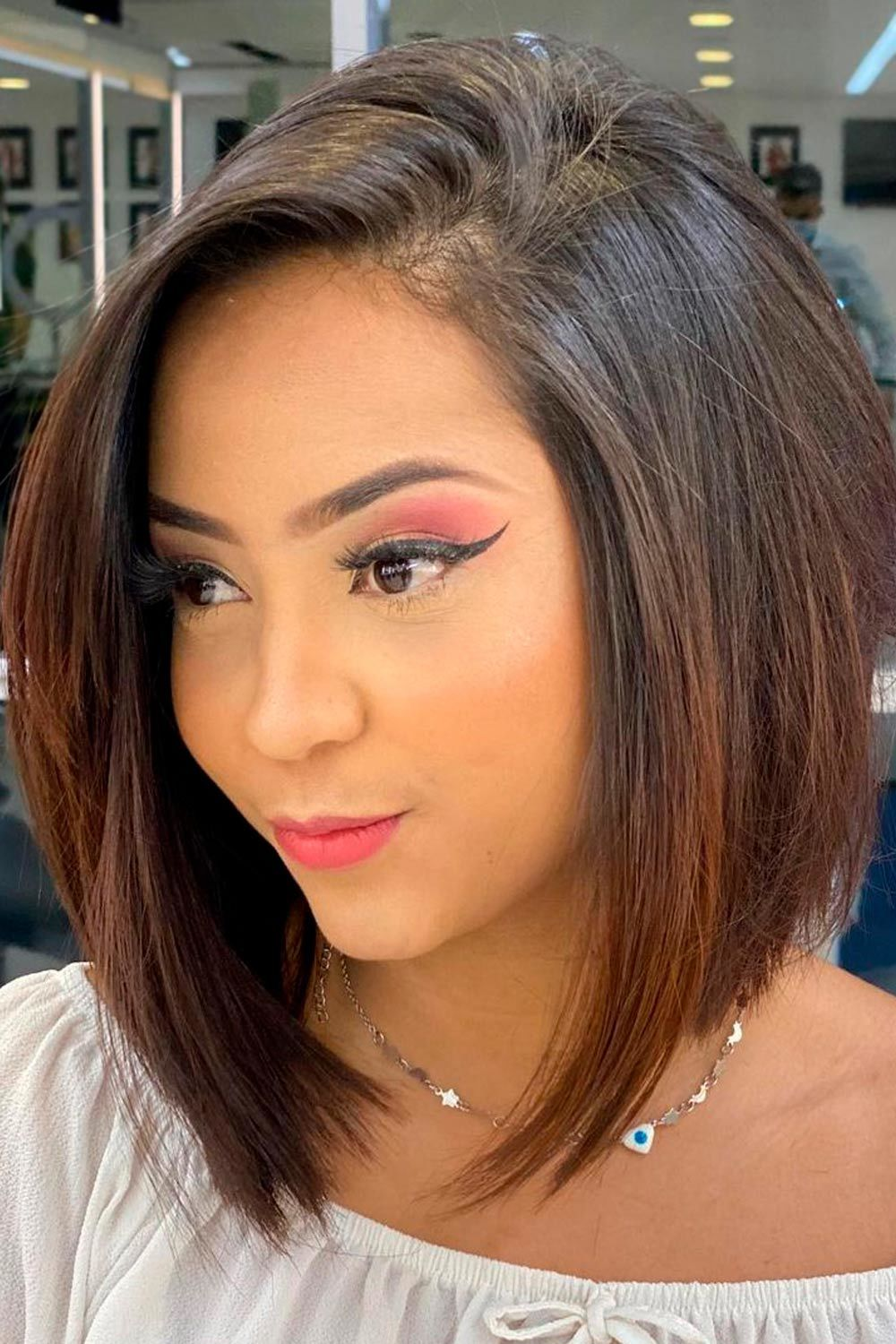 A-Line Straight Bob, short curly hairstyles for round faces, short hairstyles for women with round faces, short naturally curly hairstyles for round faces,