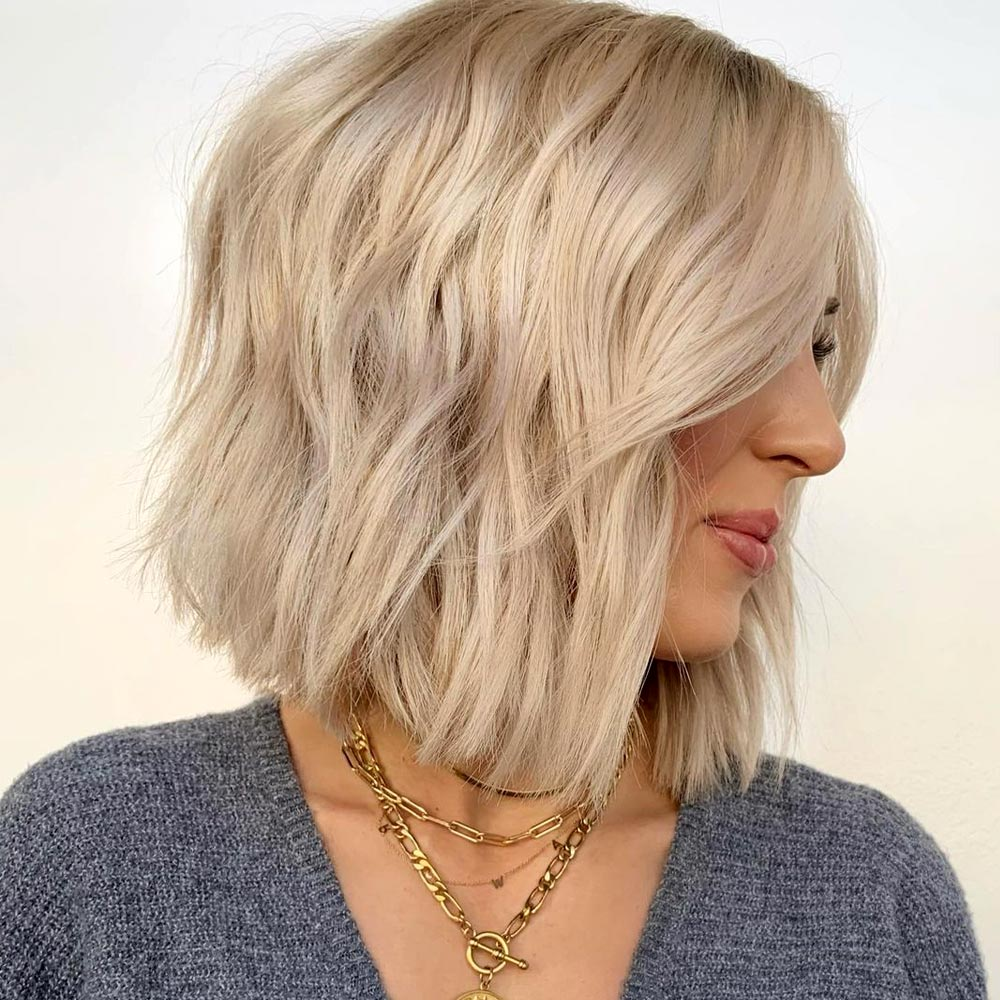 Messy Bob With A Deep Side Part