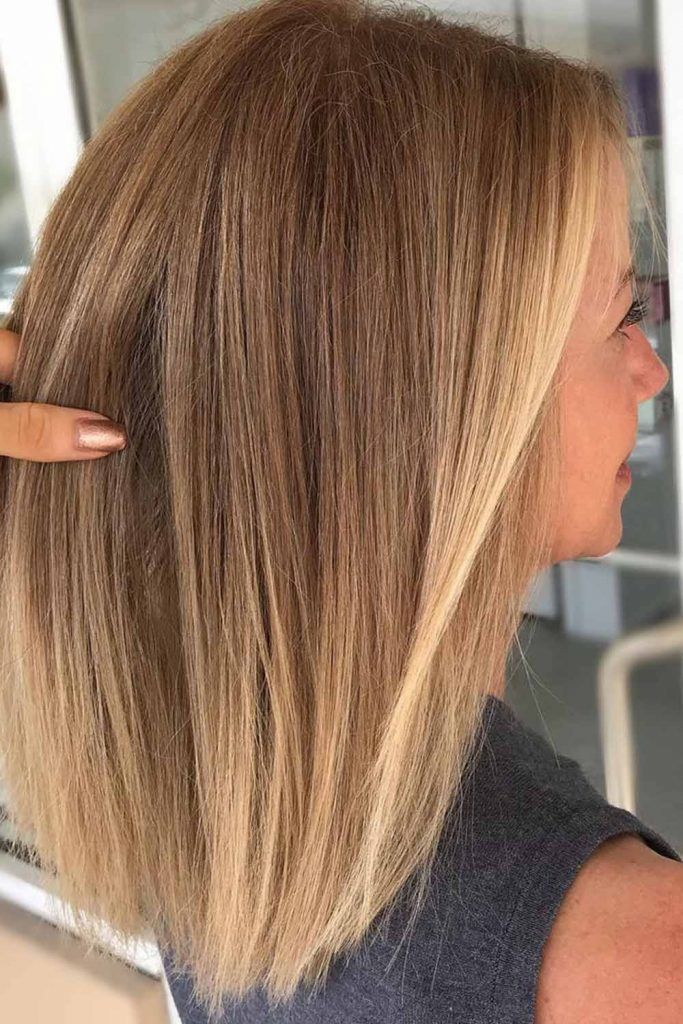 Pale To Platinum Blonde Balayage Hair For A Face Framing Style
