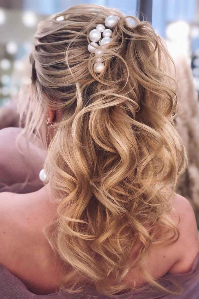 Layered Beachy Waves With High Up Pony