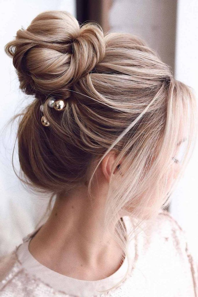 High Bun Center Parted Hairstyles With Bangs