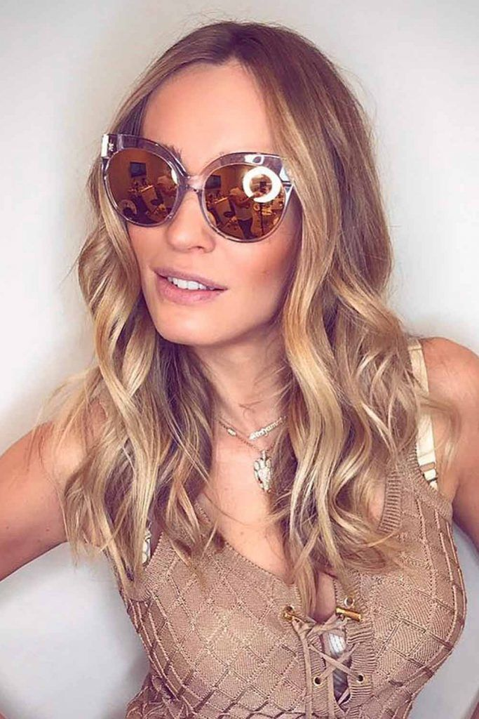 Messy Layered Caramel Brown Hairstyle With Round Brow Bar Sunglasses