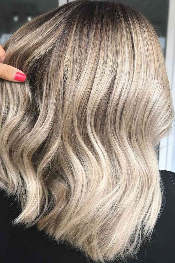 Curly Dirty Blonde Hair With Subtle Highlights