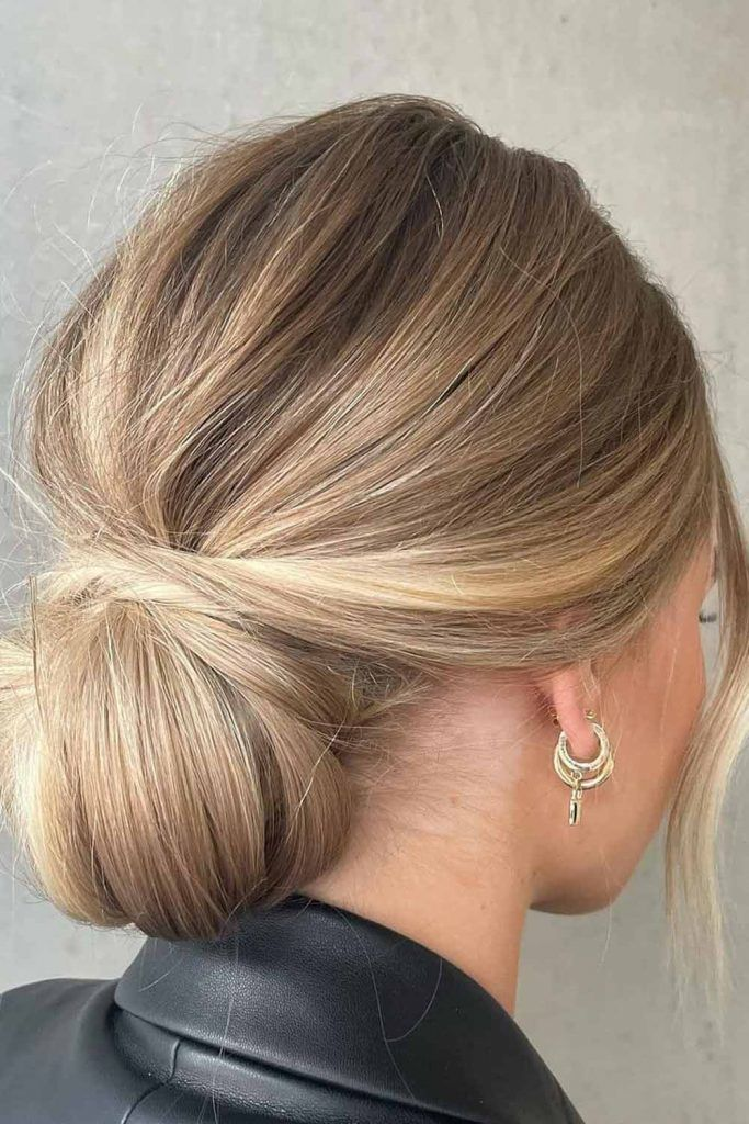 Highlighted Low Messy Bun Hairstyle