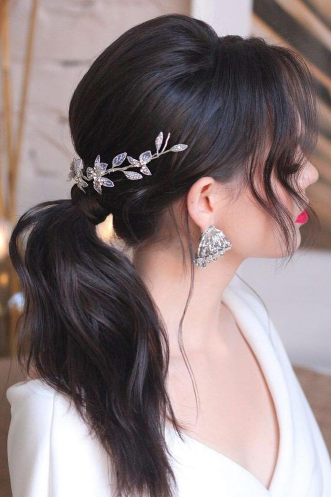Ponytail with Middle Parted Face-Framing Hair