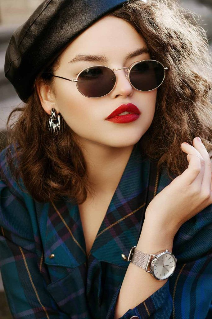 Curly Brunette Hairstyle With Round Sunglasses