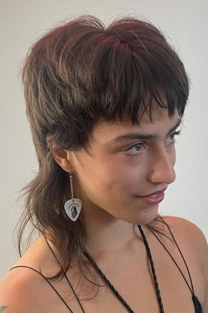 Voluminous Female Mullet with Short Bangs
