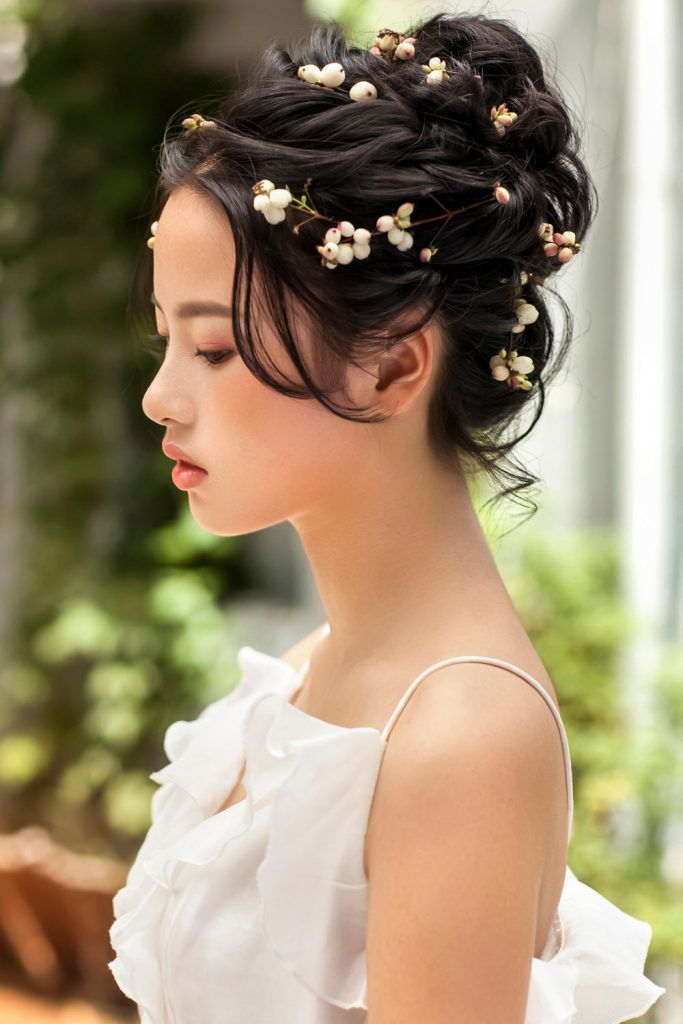 Braided Updo With Floral Accessories
